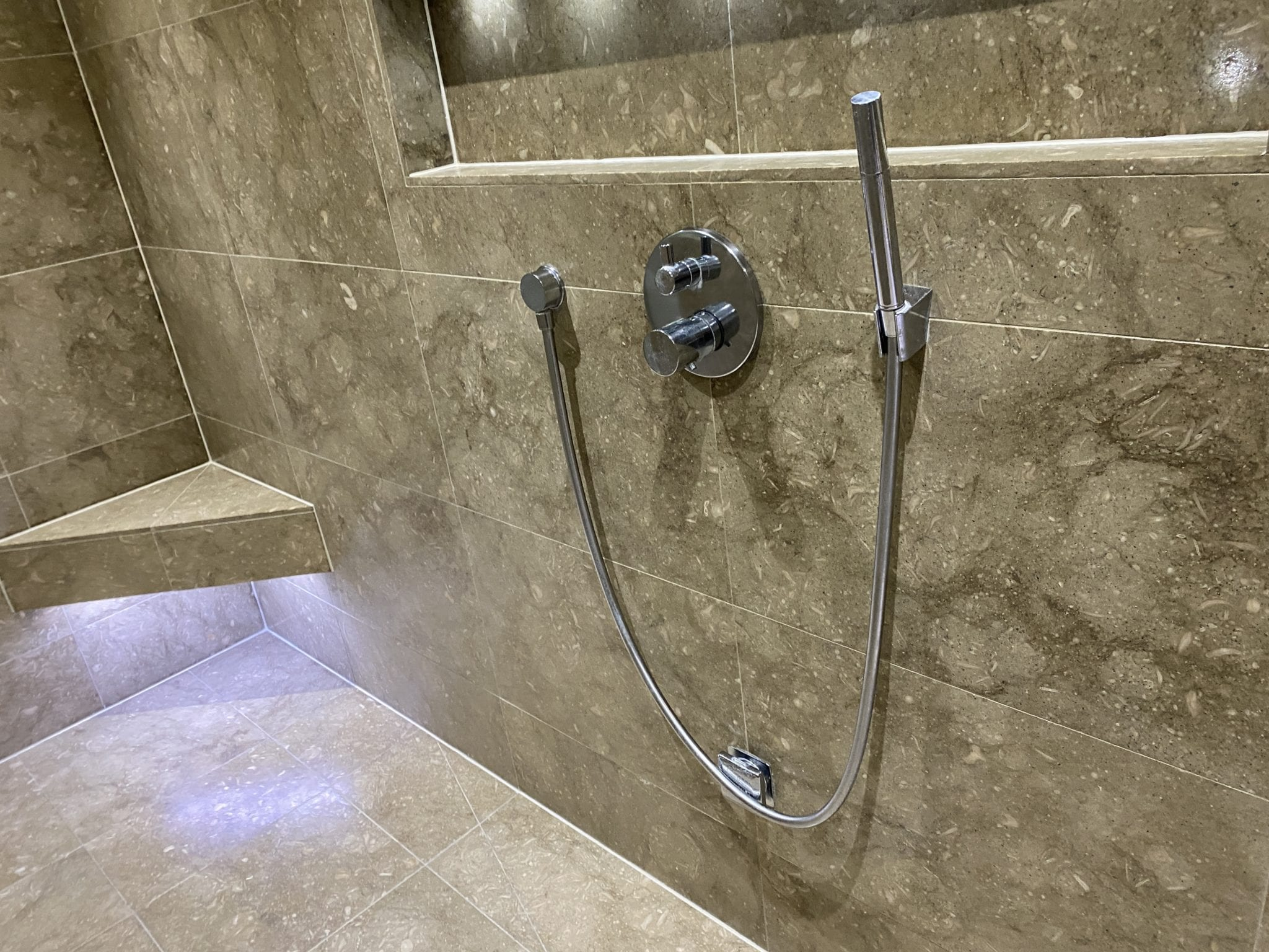 Removing limescale from stone shower walls