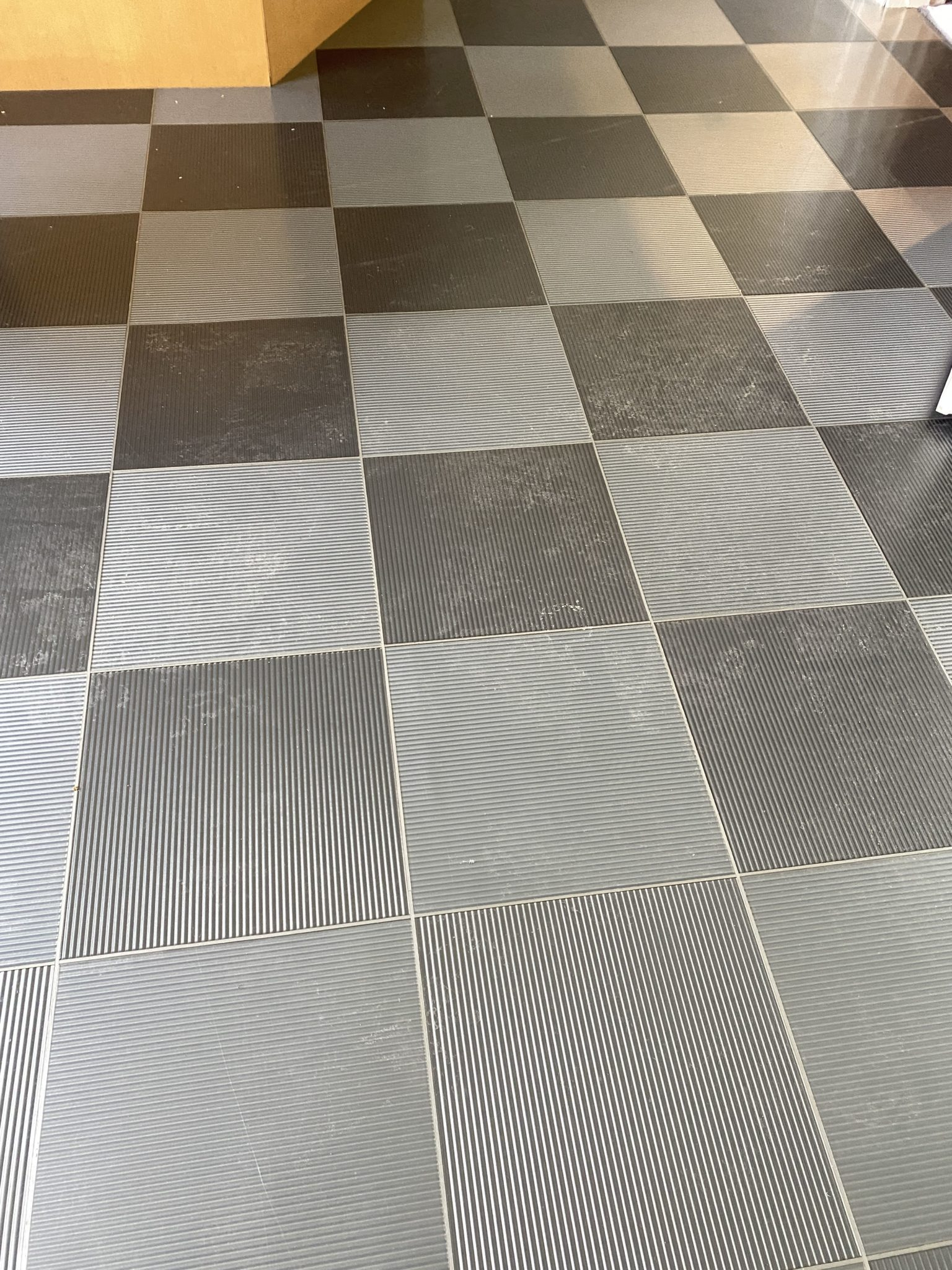 Removing polymer coating from Amtico floor. This is the before picture