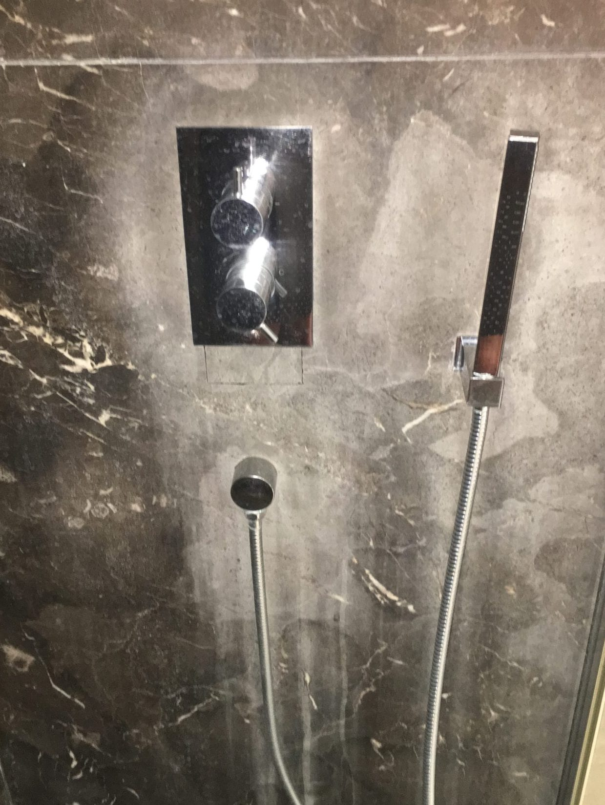 Marble shower restoration - removing limescale from stone bathroom walls