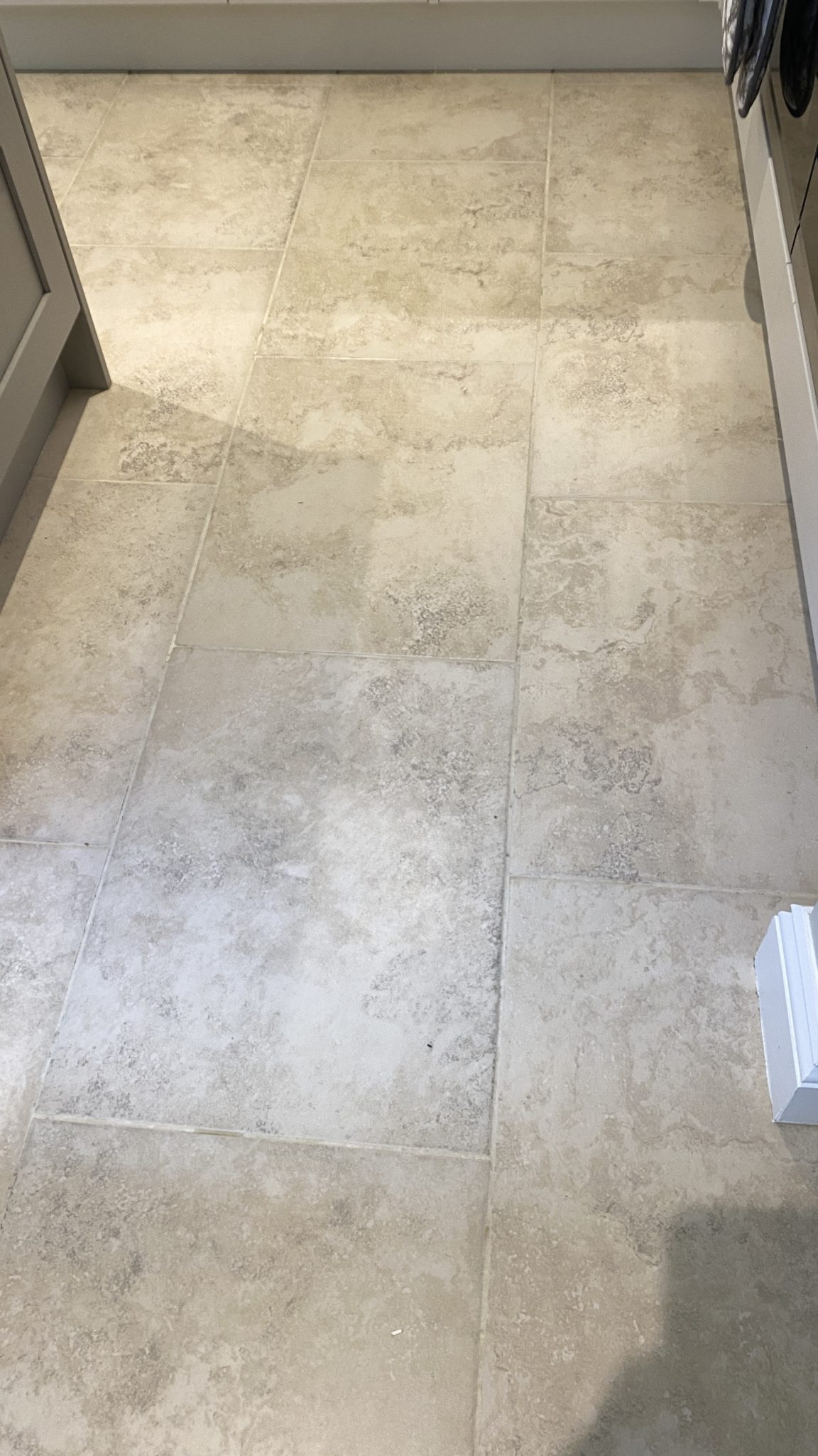 Ceramic tiled floor with cleaned grout