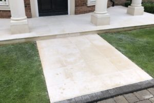 Lawn fertilizer stains on stone patio